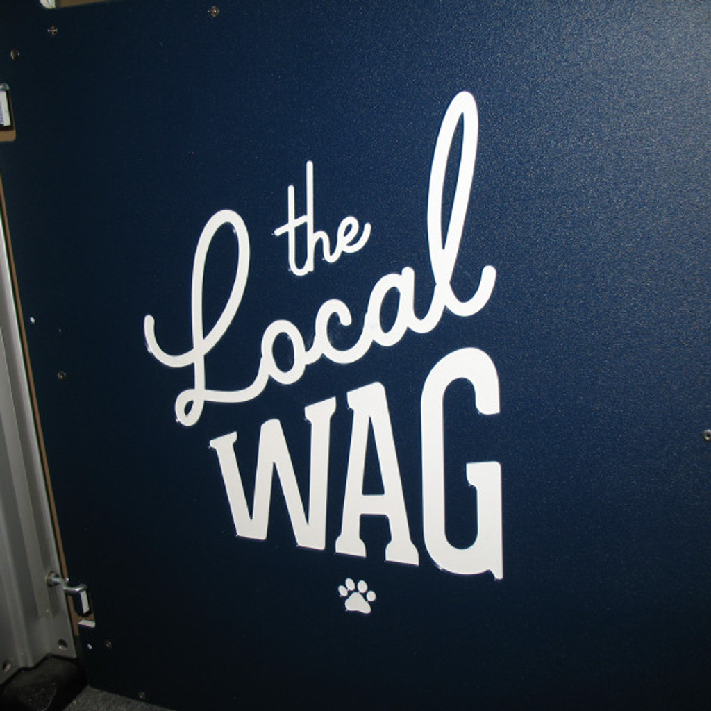 The Local Wag's custom logo on their kennel gates.