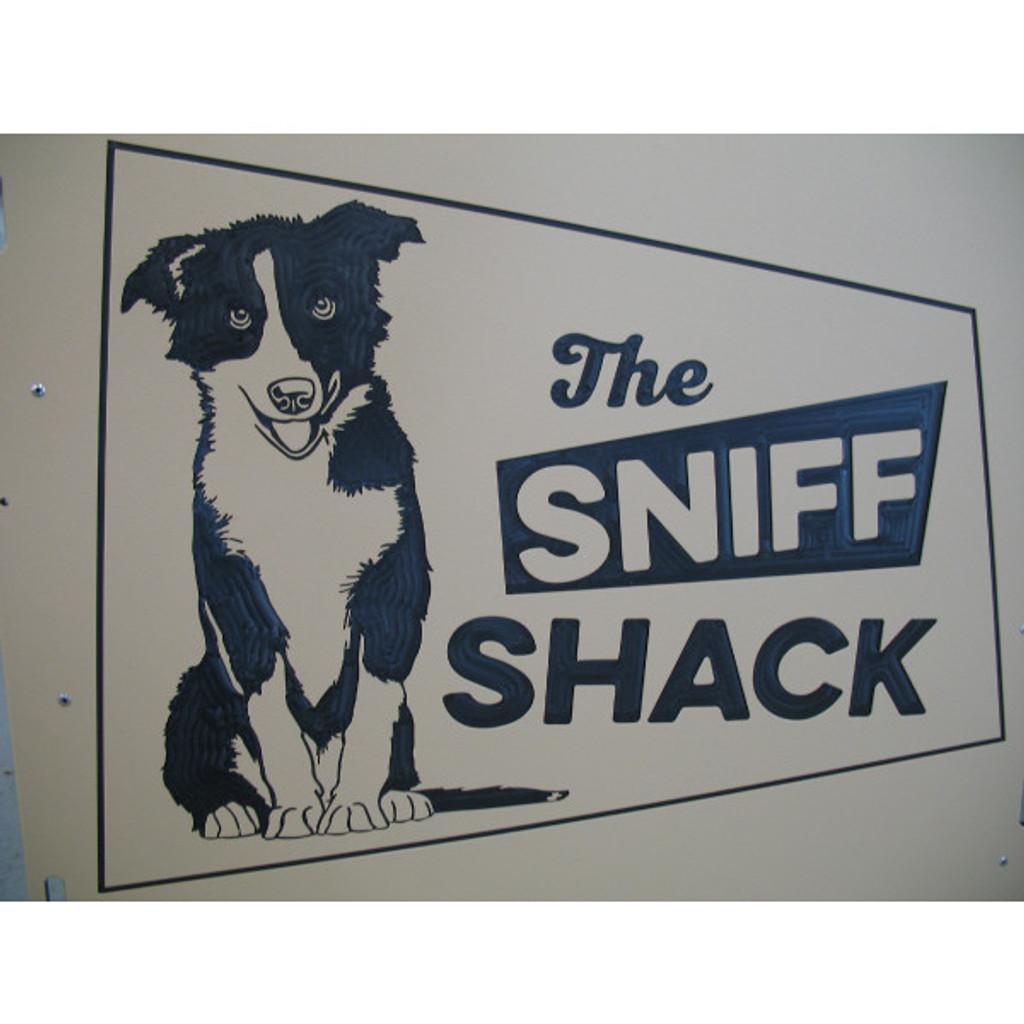 The Sniff Shack's custom logo on their kennel gates.