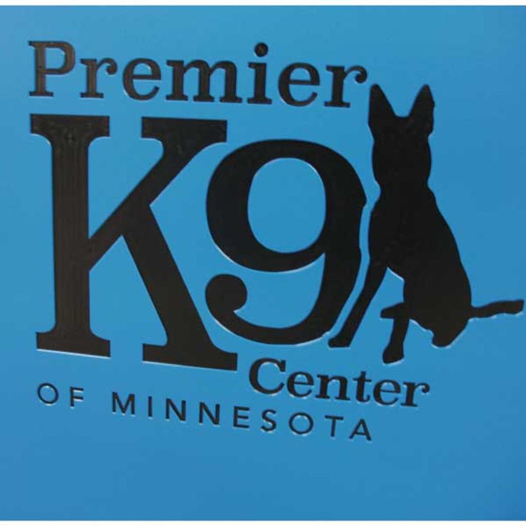 Premier K9 Center of Minnesota's custom logo on their kennel gates.