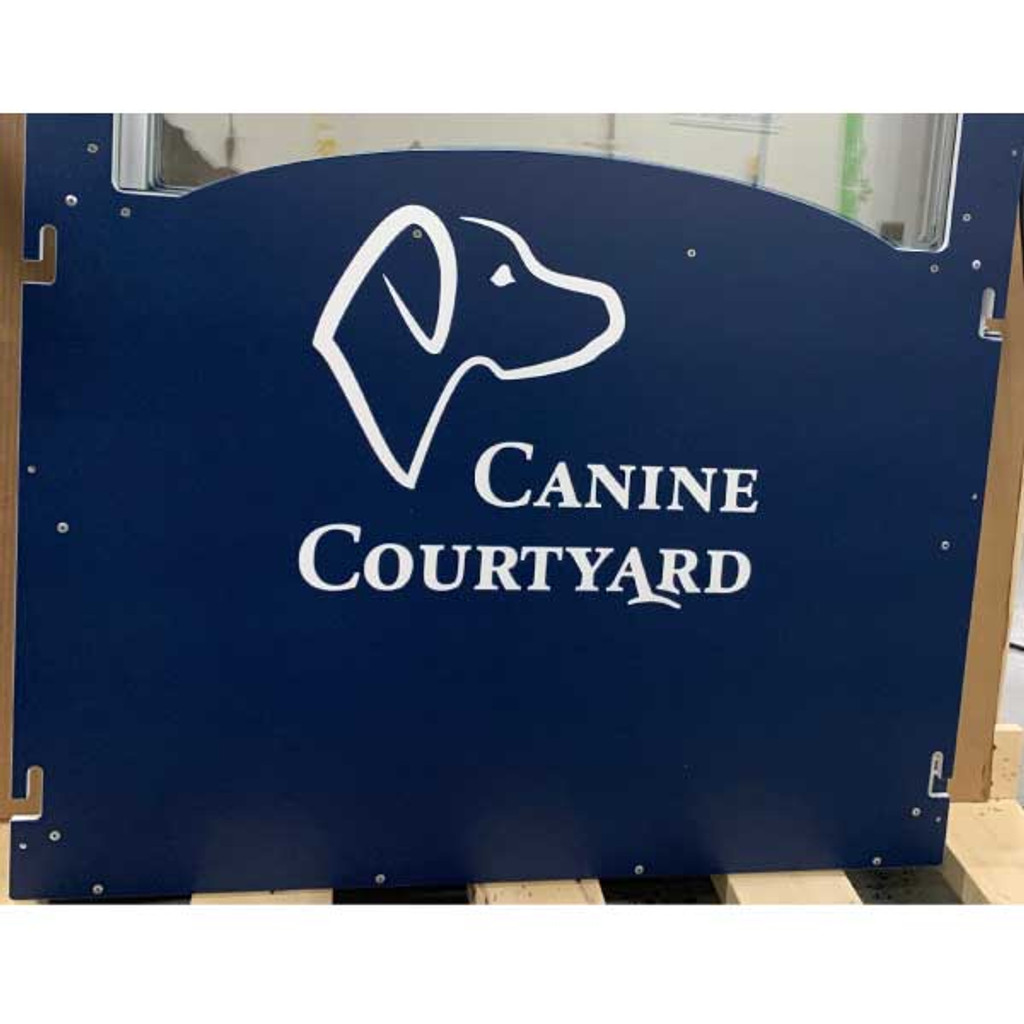Canine Courtyard's custom logo on their kennel gates in navy blue.