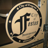 City of Festus logo on their cat cages.