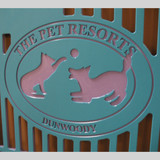 The Pet Resorts Logo engraved on kennel gates.