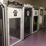 Poochville custom dog kennels in alternating colors.