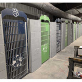 Gator Kennels green and navy custom logo gates.