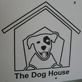 The Dog Den's custom logo on their kennel gates.