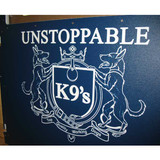 Unstoppable K9's custom logo on their kennel gates.