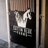 Cuttin Blue Farms' logo engraved in their Gator Kennels custom gates.