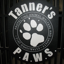 Tanners PAWS Logo on their kennel gates.