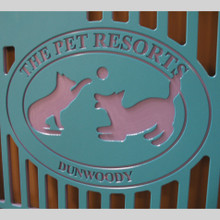The Pet Resorts Logo engraved on kennel gates.