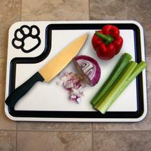 Custom plastic large cutting board in use cutting vegetables.