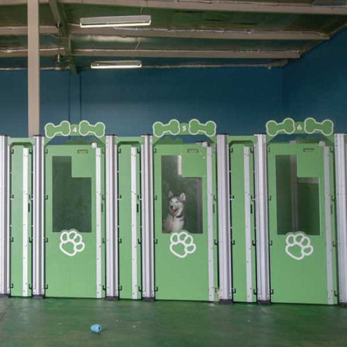 Barking Lodge Pet Resorts' Gator Kennels Signature Series kennels and a happy guest