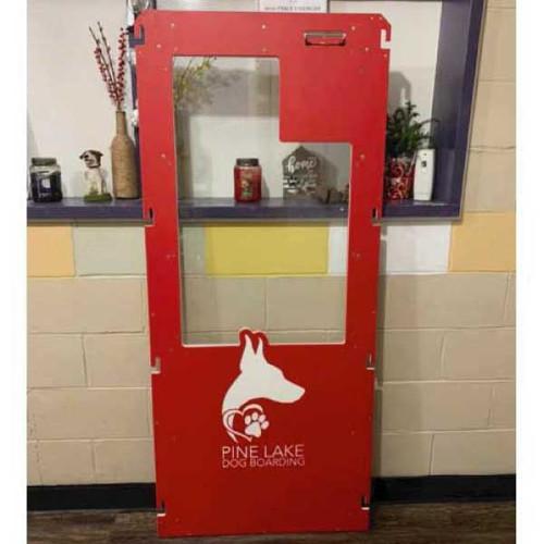 Pine Lake Dog Boarding's Gator Kennels gate in red with custom logo.