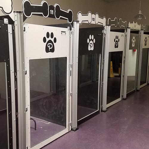 Poochville custom dog kennels in alternating colors.