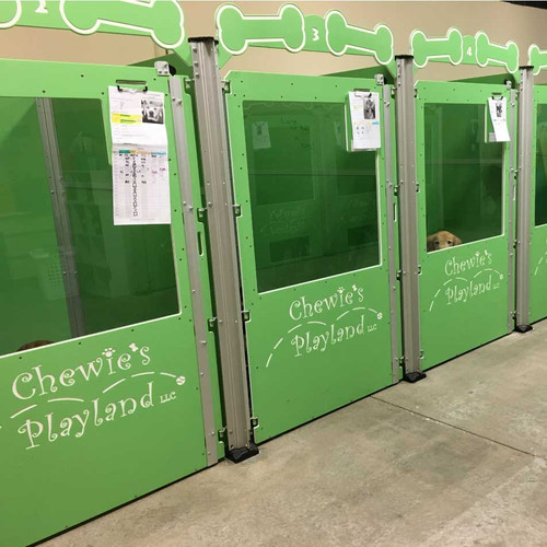 Chewie's Playland's custom green dog kennels.