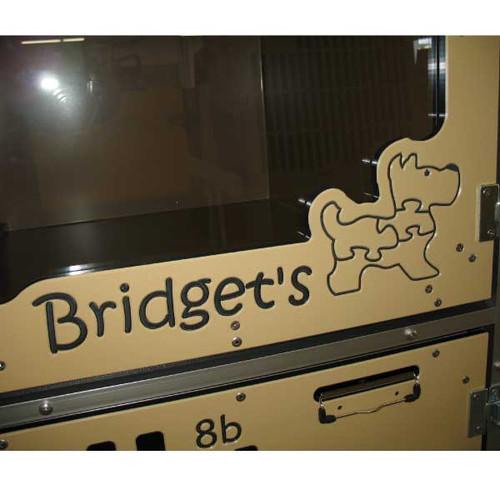 Bridget's Pet Resort's custom logo on their kennel gates.