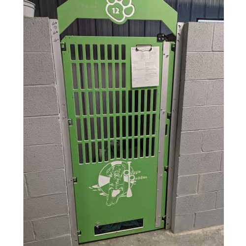 Doggie Paddle's green kennel gates with custom logo.