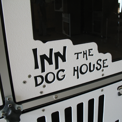 Custom logo on gates for Inn the Dog House.