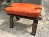Handmade Moroccan Camel Saddle stool. Orange Leather Cushion
