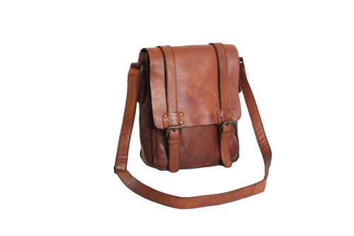 A hand crafted contemporary messenger bag with a vintage leather look and feel. Using a unique tanning process each bag is produced in the raw form and then dipped and hand finished. The messenger has decorative buckles with hidden magnetic studs for ease of use. Internal pocket and pouch, matching shoulder strap and zip pocket to the rear Heritage emobossed logo on the rear. Dimensions: 23cm x 27cm x 8cm Leather items may have wrinkles, scars, markings that are inherent characteristics and natural beauty of the hide.