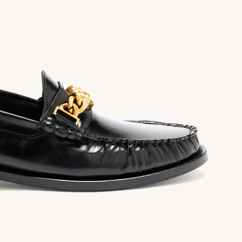 Sandro black flat leather loafers with gold buckle