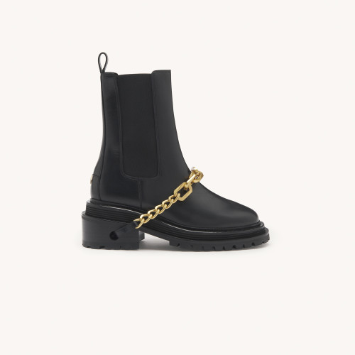 Sandro Ankle boots with notched sole and chain