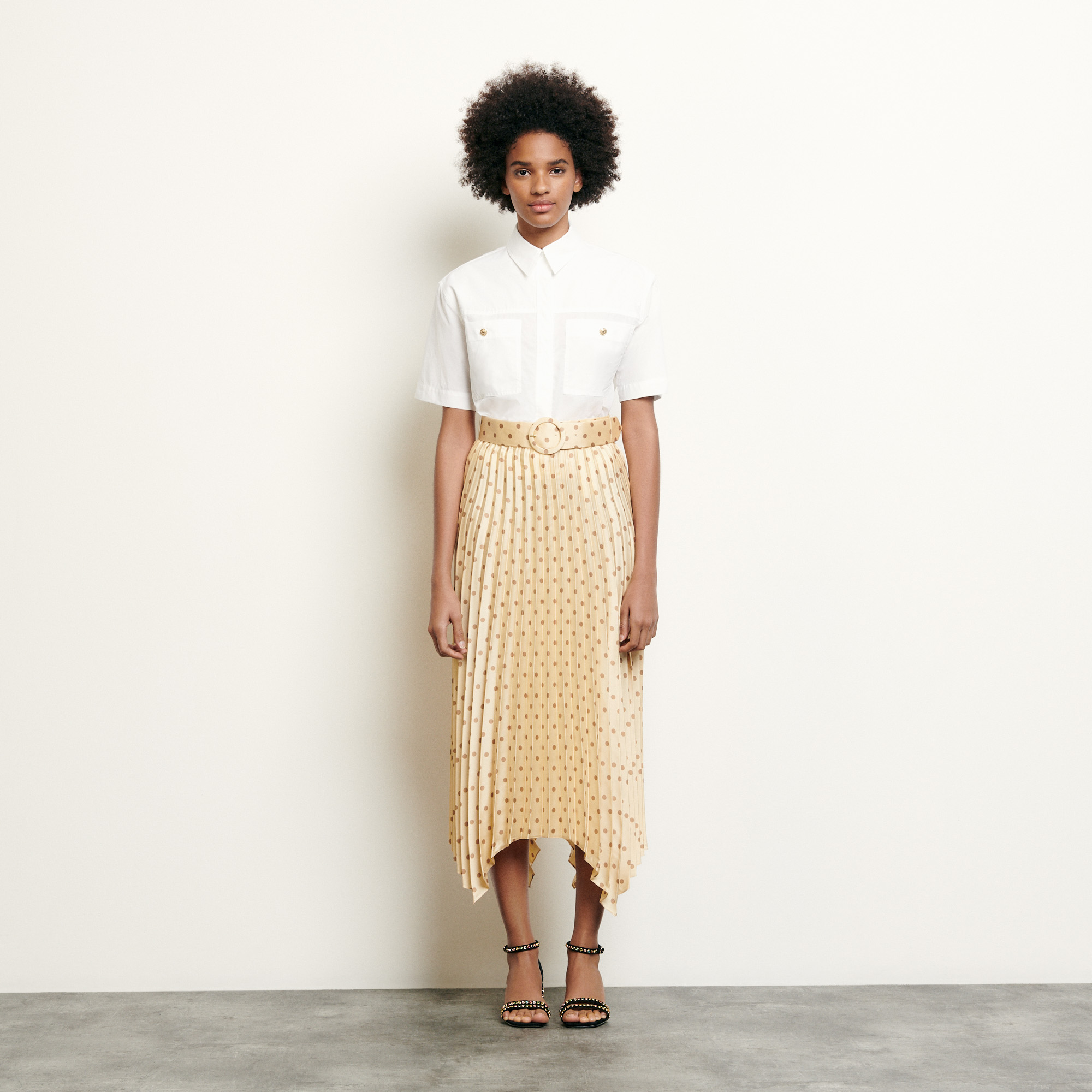 Pleated and printed skirt with belt