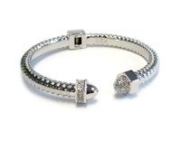 """The Ultra Woman is part of our """"Nut and Bolt"""" Collection. Design inspired by the independent and sensual woman. Silver plated accented with Czech Crystals."""