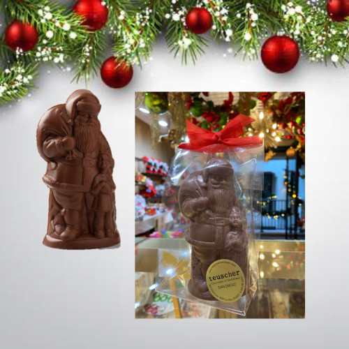 Chocolate Santa with toys and children