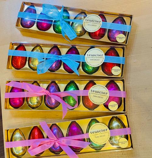 Colored foiled Half Gianduia Eggs in clear box