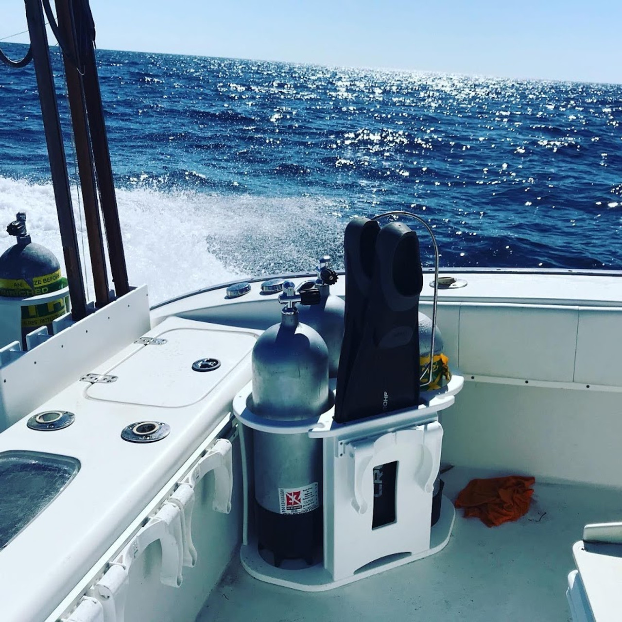 Let Mangrove Marine organize your boat to keep all your scuba diving gear, tanks fins and other items secured and not rolling around in the boat.  The 3 tank rack for the corner of the boat is a great accessory when your dive buddy doesn't have extra space for your tanks and gear.   Makes a great gift for your favorite scuba diver.   Tanks and fins not included.