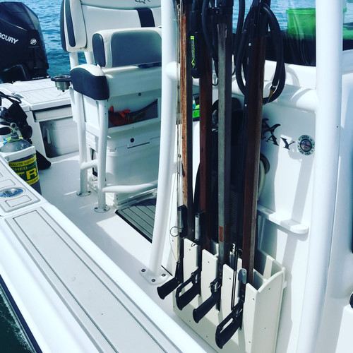 4 Speargun Rack with Fin Holder, mounted on side of console.   Spearguns are for display only and not included with speargun racks.