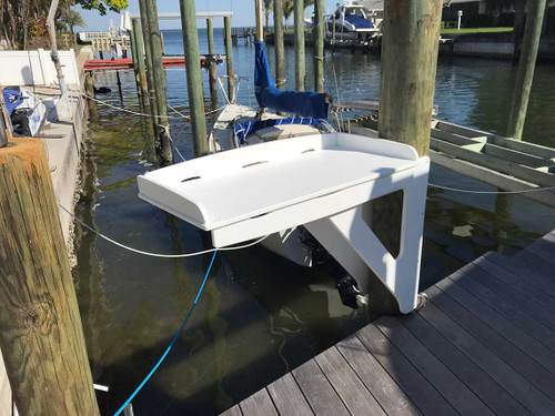 This dock cutting board by Mangrove Marine is a take off from the Yeti Top Bait Station cutting boards but mounted to your dock pole.   It is cantilevered which means it extends horizontally and is supported at only one end, so you're saving space on the dock walkway.  No legs to take up space on your dock.   Better than aluminum.