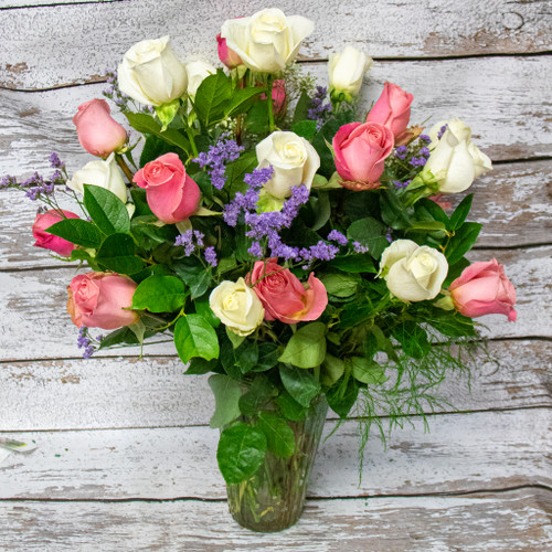 This expressive arrangement includes TWO dozen long stem fresh cut premium pink and white roses with complementary filler flowers.