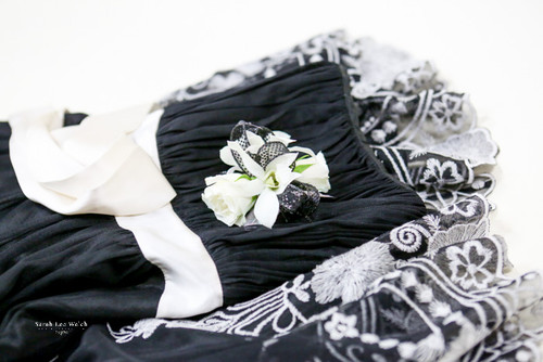 neutral white orchid corsage with black ribbon