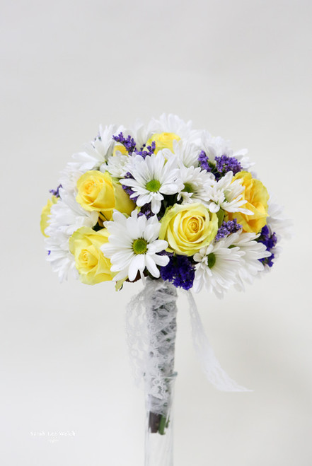 Simple Bridal Bouquet designed with Daisies and Roses.