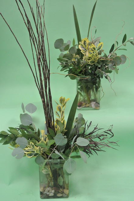 Just perfect for a sophisticated  uptown look, variety or very interesting greens in clear vase, awesome for a table accents and ceremony decorations.