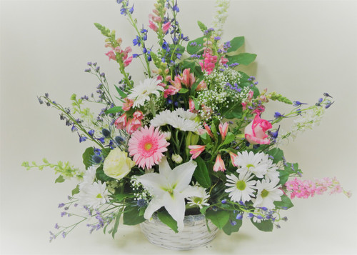 Mixed Pink and White One Sided Sympathy Tribute arranged with Local Grown Liles, Gerbera Daisies, and other mixed fresh flowers.