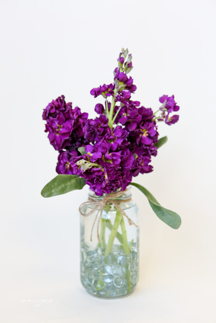 Sometimes less is better with a simple mason jar and purple stock.