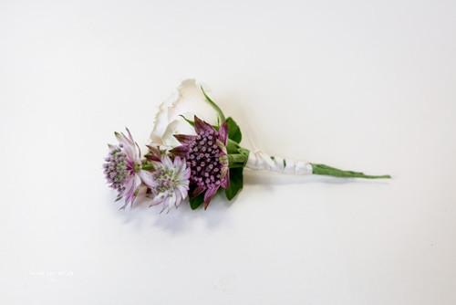 Mixed Purple and white wedding boutonniere .