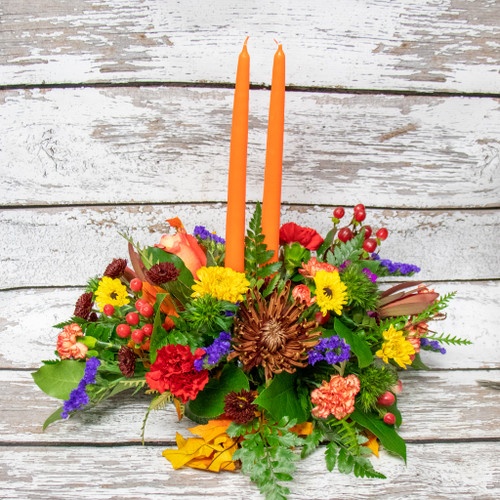 A Beautiful fall fresh flower centerpiece with two candles perfect for the table