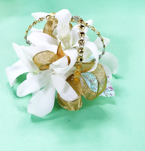This corsage is neutrally perfect! White flowers, gold accents and sparkle!