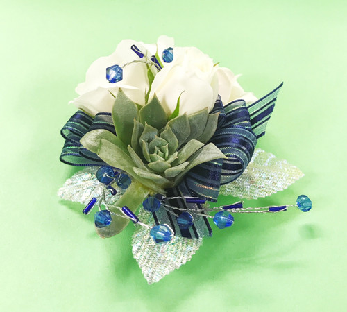 Be bold with a succulent design. Fresh flowers mixed with awesome succulent details designed by your Loveland Florist