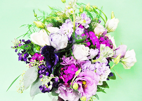 Mixed bridal Bouquet designed with a variety of fresh flowers in beautiful shades of purple