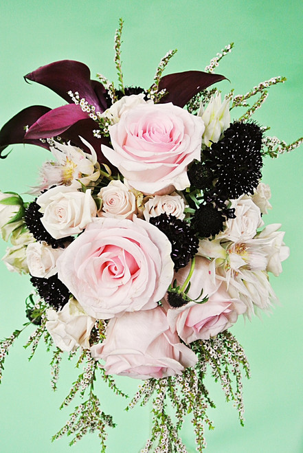 Bold Calla Lilies designed in a variety of roses and other fresh flowers for a awesome cascading Bridal Bouquet.