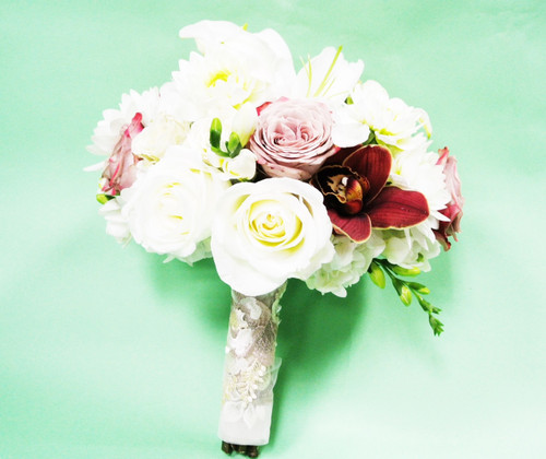 White roses designed with bright orchids and pale pink roses