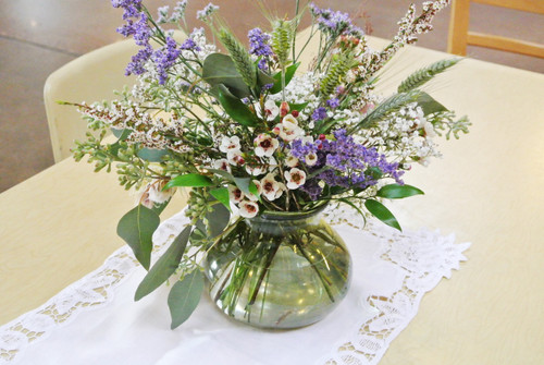 Wildflower Centerpiece Mix! Beautiful greens and wild flower styles designed in a simple vase
