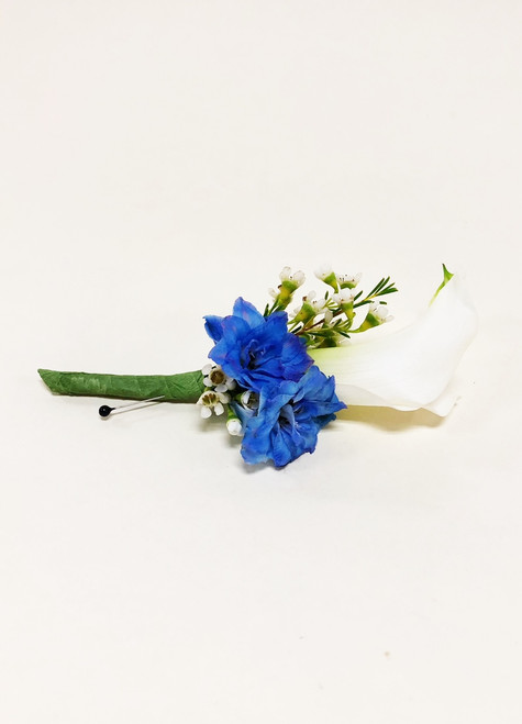 White calla lily with blue hybrid delphinium accent.