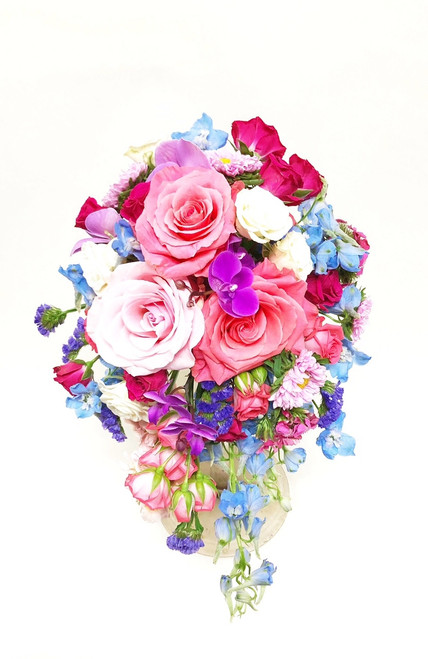 Beautiful all summer color cascading bouquet of lots of mixed and interesting flowers, including orchids, roses, asters, delphinium, dianthus and statice.