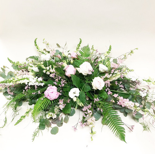 Spray for arch or arbor in soft ivories, whites and blush with lots of soft greens for that romantic look.
