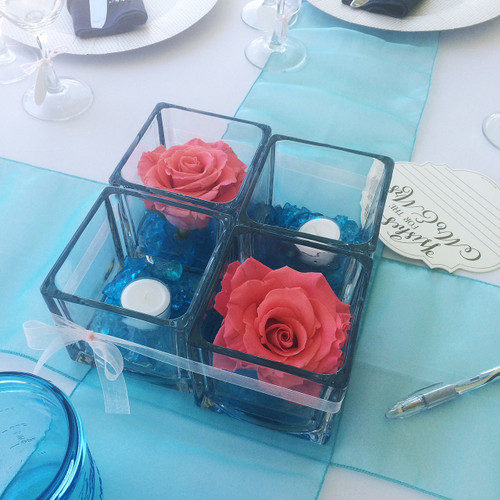 Peach and Aqua wedding cube centerpiece. Simple beautiful fresh roses. Just so FUN!!